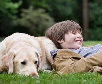 Boy talking to dog